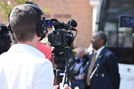 Josh Burris records Ben Carson's news conference at Cedarville University on Sept. 22.