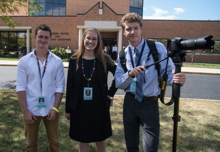 From left, Josh Burris, Anna Dembowski and Campbell Bortel worked together to cover Ben Carson's visit to Cedarville University.